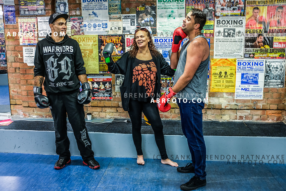 (Left to Right) Matt Day, Elizabeth Hoggard and Andrew Murray Clarke inside the gym during an open day at the Aboriginal Youth Sport and Recreation centre on Gertrude Street in Melbourne, Australia, September 1, 2017. Andrew Murray Clarke (Right) has been coming to the gym since a young boy and believes it plays a big part in creating a healthy and positive place for Aboriginal youth. Asanka Brendon Ratnayake for the New York Times