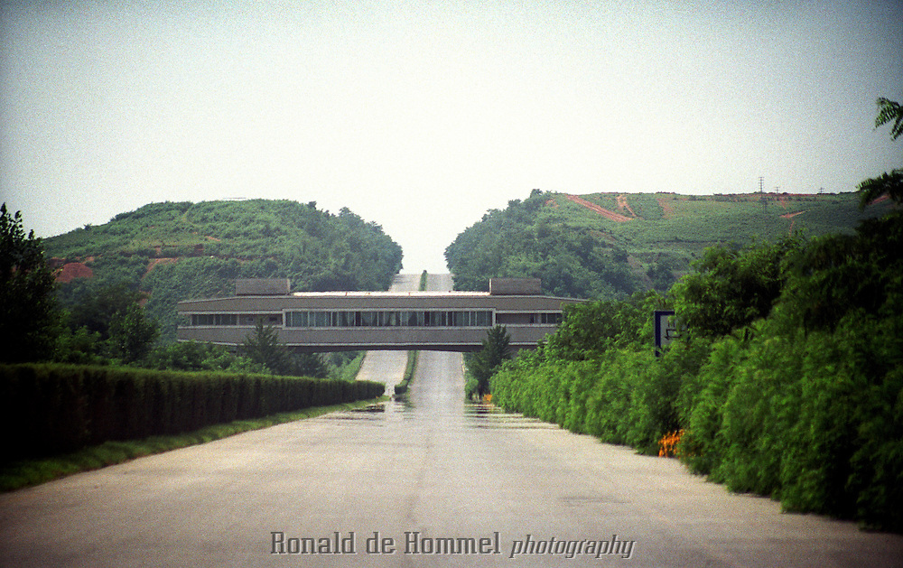 Famous road highway restaurant that supposedly contains explosives so it can be collapsed to block a possible invasion of South Korea..North Korea, july 2001.