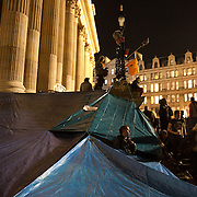 A shelter made out of tarpoulin next to the front steps to the cathedral. The London Stock Exchange was attempted occypied in solidarity with Occupy Wall in Street in New York and in protest againts the economic climate, blamed by many on the banks. Police managed to keep people away fro the Patornoster Sqaure and the Stcok Exchange and thousands of protestors stayid in St. Paul's Square, outside St Paul's Cathedral. Many camped getting ready to spend the night in the square.
