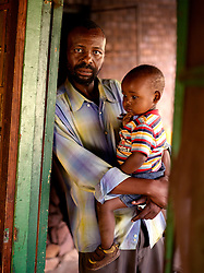 "Edgar Tshepo (b. 1970) joined MK in 1986 and went to Angola to train in military tactics and anti-aircraft.  He has two children and currently lives in an abandoned house while he waits for government assistance to begin a community greenhouse project.  ""I found myself in the situation that if i don't go and train I will die . . .  was trained in military tactic and anti aircraft , but what am I doing with those skills today?""."