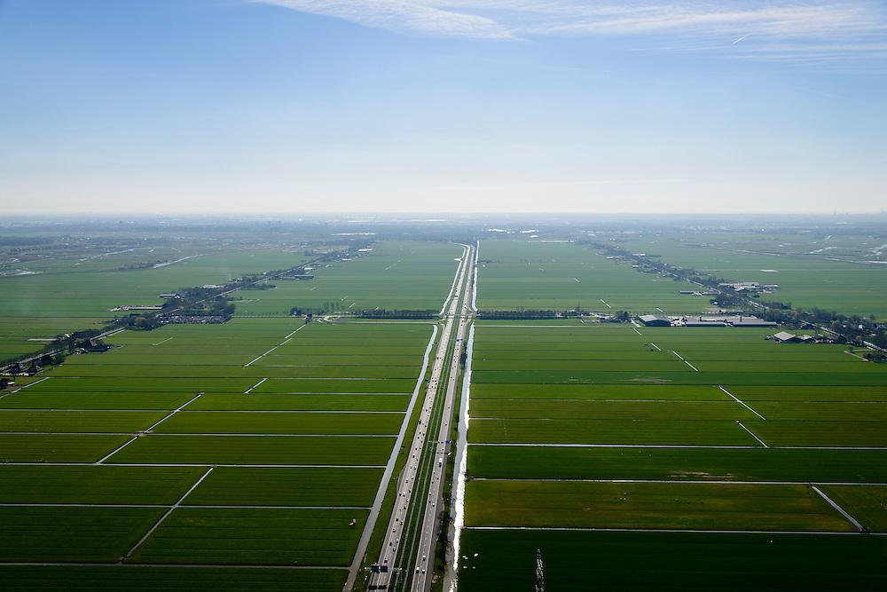 Nederland, Noord-Holland, Gemeente Purmerend, 20-04-2015; polder Wijdewormer, droogmakerij uit de 17e eeuw. Autosnelweg A7 doorsnijdt het gebied.<br /> Wijdewormer polder, reclaimed land dating from the 17th century. The original landscape has been affected by the construction of motorway A7.<br /> luchtfoto (toeslag op standard tarieven);<br /> aerial photo (additional fee required);<br /> copyright foto/photo Siebe Swart