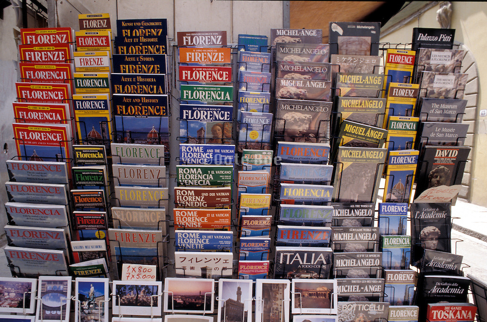 Italian guide and travel brochures on magazine racks