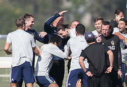 March 30, 2018 - Carson, California, U.S - Zlatan Ibrahimovic #9 of the LA Galaxy is received by teammates during his first practice on Friday March 30, 2018 at the StubHub Center in Carson, California. (Credit Image: © Prensa Internacional via ZUMA Wire)