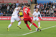 midfielder James Berrett has a shot on goal during the Capital One Cup match between Swansea City and York City at the Liberty Stadium, Swansea, Wales on 25 August 2015. Photo by Simon Davies.