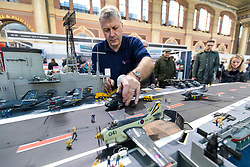 19/01/2018. London, UK. Dave Fortey arranges a helicopter on the deck of his model of HMS Ark Royal (R09) at the London Model Engineering Exhibition at Alexandra Palace. Fortey, a former Royal Navy mechanic and sub-lieutenant, built the model over 25 years. It is the first time it has been put on display to the public. Photo credit: Rob Pinney