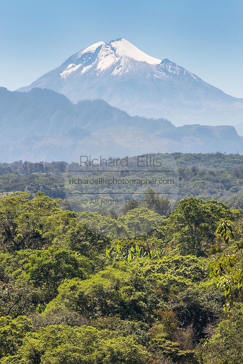 The snowcapped Cofre de Perote volcano dominates the jungle near Xico, Veracruz, Mexico. The inactive volcano last erupted 900-year-ago and is the eighth highest mountain in Mexico.