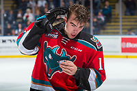 KELOWNA, CANADA - OCTOBER 27: Erik Gardiner #12 of the Kelowna Rockets touches his head after colliding with the puck against the Tri-City Americans on October 27, 2017 at Prospera Place in Kelowna, British Columbia, Canada.  (Photo by Marissa Baecker/Shoot the Breeze)  *** Local Caption ***