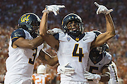 AUSTIN, TX - SEPTEMBER 19:  Kenny Lawler #4 of the California Golden Bears celebrates after catching a touchdown against the Texas Longhorns on September 19, 2015 at Darrell K Royal-Texas Memorial Stadium in Austin, Texas.  (Photo by Cooper Neill/Getty Images) *** Local Caption *** Kenny Lawler