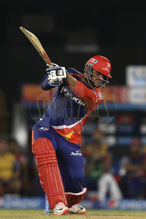 Saurabh Tiwary of the Delhi Daredevils drives a delivery during match 45 of the Pepsi IPL 2015 (Indian Premier League) between The Delhi Daredevils and the Sunrisers Hyderabad held at the Shaheed Veer Narayan Singh International Cricket Stadium in Raipur, India on the 9th May 2015.<br /> <br /> Photo by:  Shaun Roy / SPORTZPICS / IPL