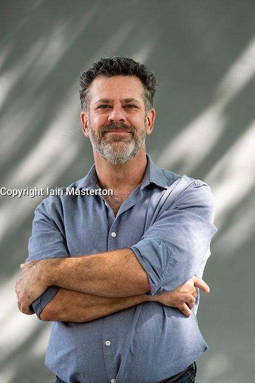 "Edinburgh, Scotland, UK; 15 August, 2018. Pictured;  Author Michael Redhill. Redhill's Giller prize-winning novel ""Bellevue Square"" follows Jean a bookshop owner in downtown Toronto whose customers begin claiming they're seeing her doppelgänger."