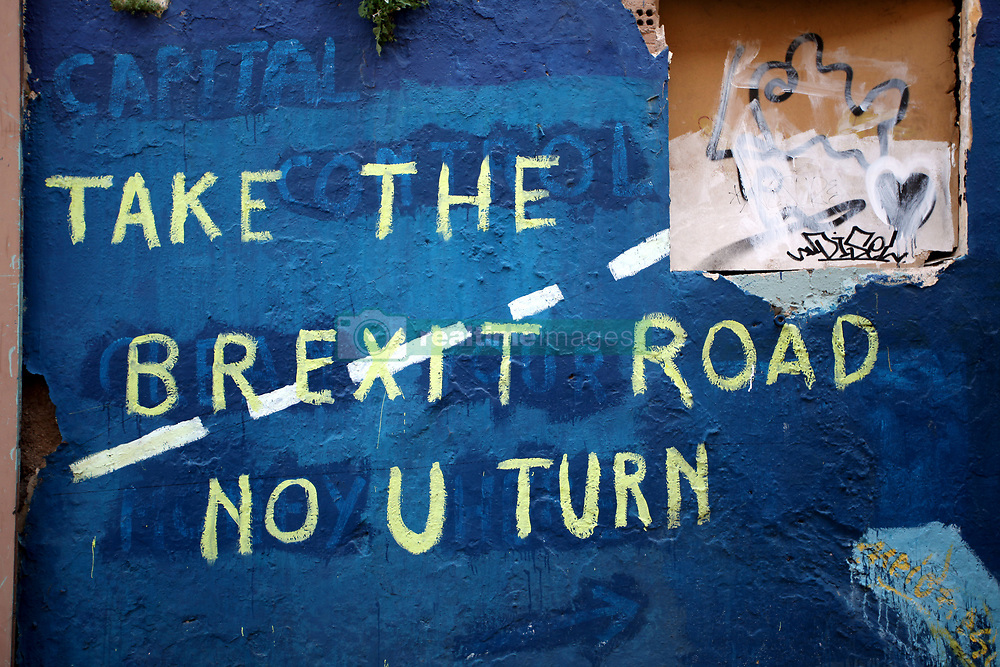 March 22, 2019 - Athens, Attica, Greece - A graffiti about Brexit is seen in Athens city centre, Greece on March 22, 2019. The graffiti reads 'Take the Brexit Road, No U Turn'. Theresa May asked for an extension to Brexit while EU Commission President, Donald Tusk said that the EU would grant a short extension to Article 50, if Theresa May can get approval for her withdrawal agreement from Parliament before next Friday. (Credit Image: © Giorgos Georgiou/NurPhoto via ZUMA Press)