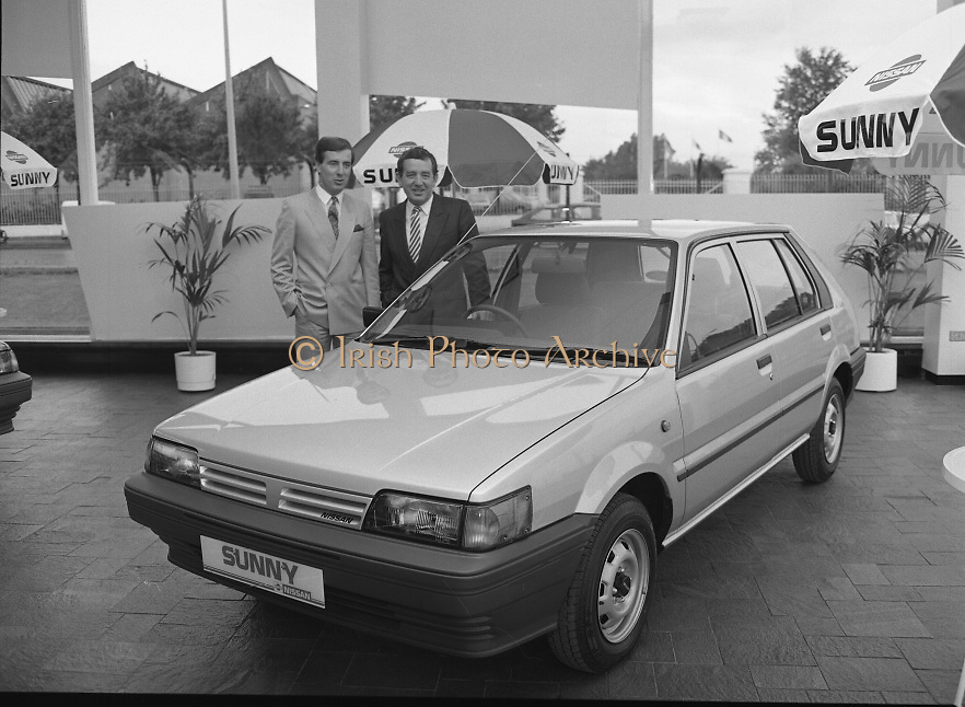 "Nissan Launches New ""Sunny""..1986..21.08.1986..08.21.1986..21st August 1986..Nissan Ireland launched the all new integrated Sunny range on to the Irish market.The launch was the European premiere of this model and marked a significant second phase in the rationalisation of the Nissan Product range. The first Phase was the launch of the Bluebird range in February of this year. The Launch took place at Nissan House, Naas Road Dublin...Pictured admiring the new Nissan ""Sunny"" hatchback were Mr Gerard O'Toole,Managing Director and Mr Michael Murphy,sales Director,Nissan Ireland."