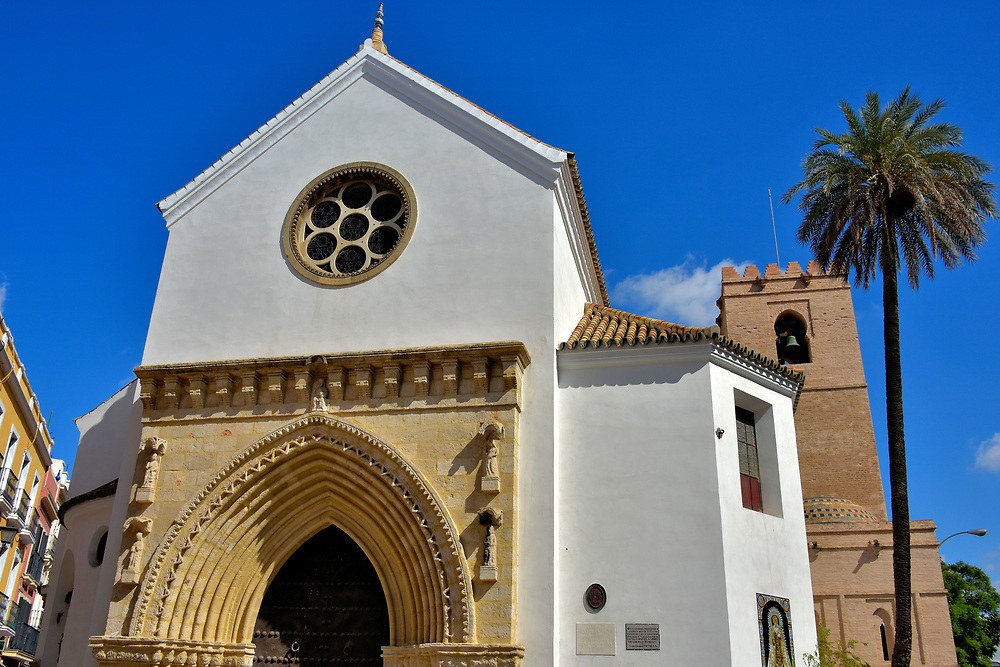 Santa Catalina Church in Seville, Spain<br /> Santa Catalina Church and its rear bell tower were built on an existing mosque during the 14th century. Similar to many medieval churches in Seville, it has been declared a Spanish Property of Cultural Interest. The fa&ccedil;ade features a simple yet elegant rose window and tympanum. This Gothic entrance once fronted the Church of Santa Luc&iacute;a. In 1929, it was retrofit onto Santa Catalina Church over a Mud&eacute;jar-style portal.