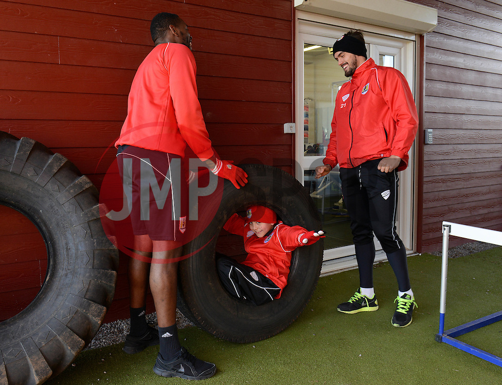 Bristol City's Marlon Pack and Bristol City's Jay Emmanuel-Thomas joke around with Connor - Photo mandatory by-line: Dougie Allward/JMP - Mobile: 07966 386802 - 01/04/2015 - SPORT - Football - Bristol - Bristol City Training Ground - HR Owen and SAM FM