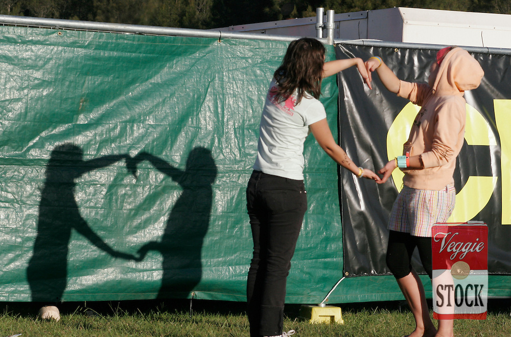 Girls make shapes with their shadow at the Great Escape music festival in Sydney, Sunday, April 8, 2007. The festival is in its second year and runs over the Easter long weekend. (credit: Megan Young)