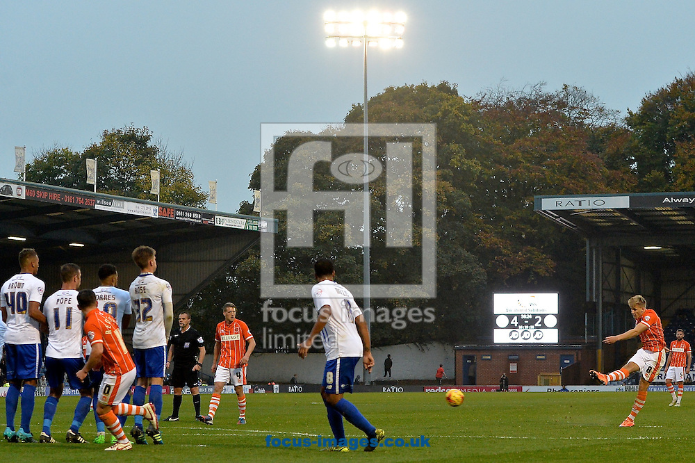 Brad Potts of Blackpool (right) hits a free kick during the Sky Bet League 1 match at Gigg Lane, Bury<br /> Picture by Ian Wadkins/Focus Images Ltd +44 7877 568959<br /> 31/10/2015
