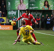 Leeds United defender Charlie Taylor performing a sliding tackle during the Sky Bet Championship match between Charlton Athletic and Leeds United at The Valley, London, England on 12 December 2015. Photo by Matthew Redman.
