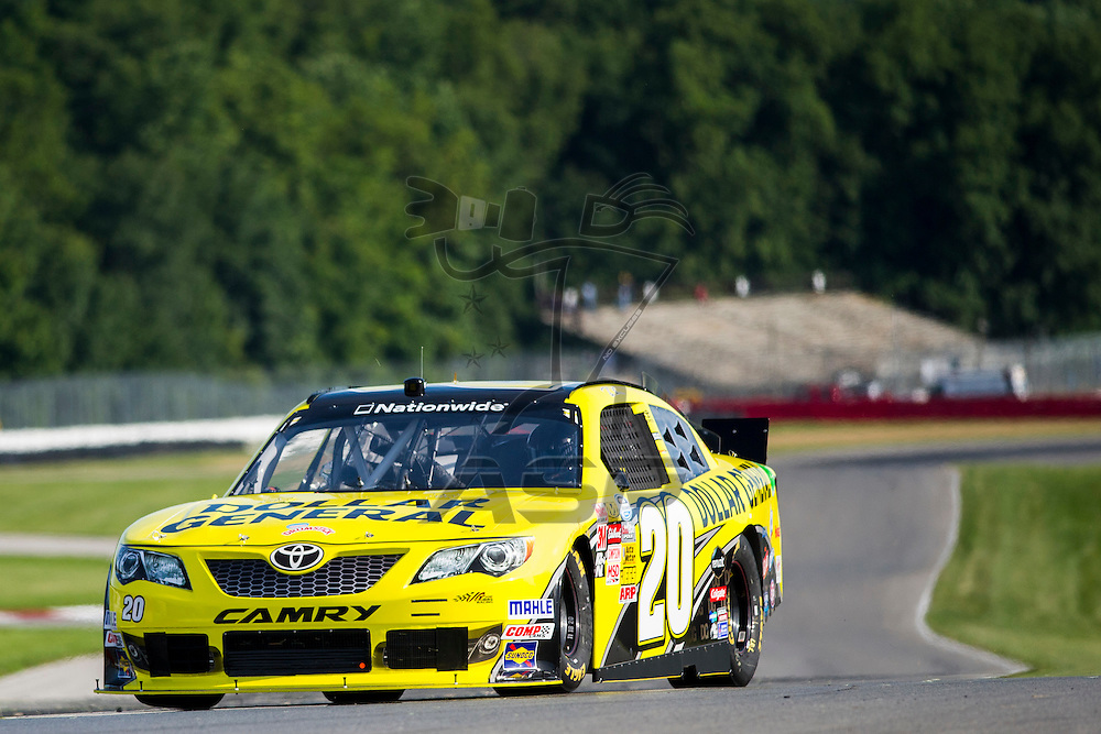 """Lexington, OH - AUG 15, 2013: The NASCAR Nationwide Series teams take to the track during practice for the Nationwide Children's Hosp. 200 at the Mid-Ohio Sports Car Course in Lexington, OH, Vickers, JGR, Gibbs, Toyota, 20, """"Dollar Genreal"""","""