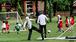 © Licensed to London News Pictures. 10/06/2017. London, UK. Leader of the Labour Party JEREMY CORBYN visits a local children's football match with Head of Strategic Communications JAMES SCHNEIDER. The Labour party made significant gains earlier this week in a general election The Conservative Party were expected to win comfortably. Photo credit: Ben Cawthra/LNP