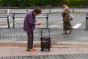 Two old women in a park near Ikebukuro Station Ikebukuro, Tokyo, Japan. Friday July 15th 2016