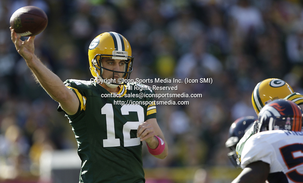 Oct. 2, 2011 - Green Bay, WI, USA - Aaron Rodgers of the Green Bay Packers throws a pass in the first quarter against the Denver Broncos at Lambeau Field in Green Bay, Wisconsin, Sunday, October 2, 2011. The Packers defeated the Broncos, 49-23