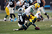 Green Bay Packers wide receiver Geronimo Allison (81) catches a pass but fumbles the ball on a hit by Carolina Panthers cornerback James Bradberry (24) late in the fourth quarter on a game winning play by the Panthers during the 2017 NFL week 15 regular season football game against the Carolina Panthers, Sunday, Dec. 17, 2017 in Charlotte, N.C. The Panthers won the game 31-24. (©Paul Anthony Spinelli)