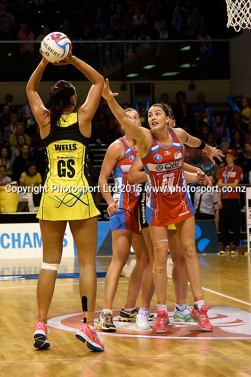 Pulse's Ameliaranne Wells (L) takes a shot at goal with Swifts' Sharni Layton in defense during the ANZ Championship - Pulse v Swifts netball match at the TSB Arena in Wellington on Saturday the 25th of April 2015. Photo by Marty Melville / www.Photosport.co.nz