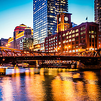 Picture of Chicago at night with Clark Street Bridge. Photo includes the Reid Murdoch building (Encyclopaedia Britannica building) and Merchandise Mart building.