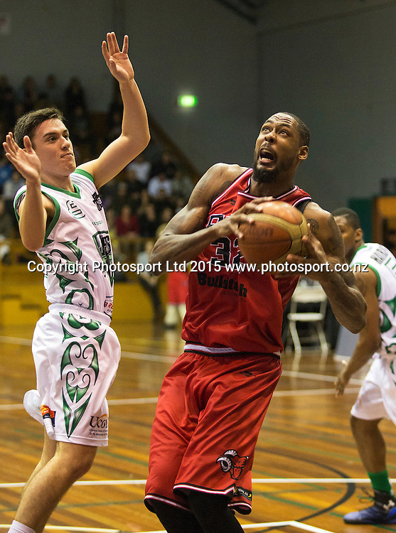 Mickell Gladness of the Rams with the ball and Derone Raukawa of the Jets in defence during the National Basketball League game between the Canterbury Rams v Manawatu Jets at Cowles Stadium in Christchurch. 10th April 2015 Photo: Joseph Johnson/www.photosport.co.nz