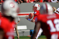 Quarterback Ryan Finley looks down field during homecoming game action in Carter-Finley Stadium.