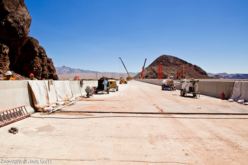 19 AUGUST 2010 --  HOOVER DAM, AZ: Cranes on the bridge deck. Construction work is continuing on the Hoover Dam bypass bridge. The Colorado River Bridge is the central portion of the Hoover Dam Bypass Project. Construction on the nearly 2,000 foot long bridge began in late January 2005 and the completion of the entire Hoover Dam Bypass Project is expected in late 2010.  When completed, this signature bridge will span the Black Canyon (about 1,500 feet south of the Hoover Dam), connecting the Arizona and Nevada Approach highways nearly 900-feet above the Colorado River.  PHOTO BY JACK KURTZ