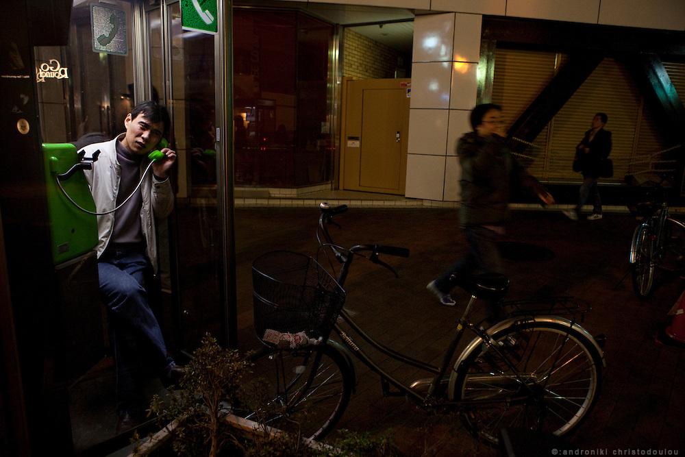 Man inside a phonebox in Nichome