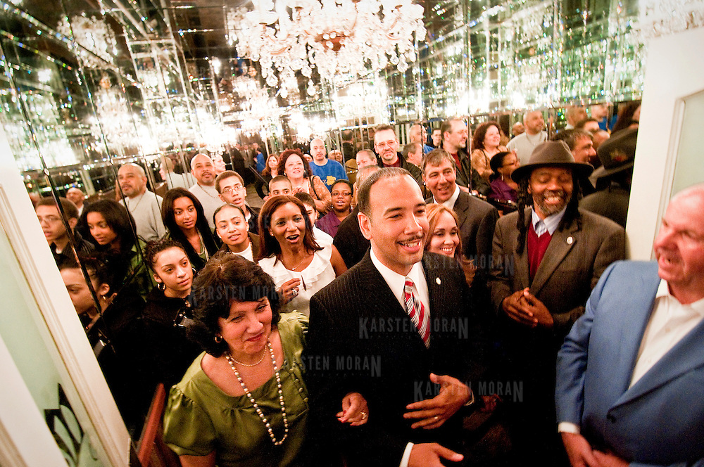 April 21, 2009 - Bronx, NY : Surrounded by supporters and with his wife Hilda Gerena Diaz (in green) by his side, Ruben Diaz Jr. (center) makes his entrance. Assemblyman RubÈn DÌaz Jr. gathered with supporters at Maestro's in Morris Park, the east Bronx, on Tuesday night to celebrate his victory for the seat of Bronx borough president over Anthony J. Ribustello.  My Diaz,  who collected 87% of the vote, was joined by Bronx Democratic leaders including Assemblyman Jeffrey Dinowitz and Diaz's father, State Senator Ruben Diaz Sr.