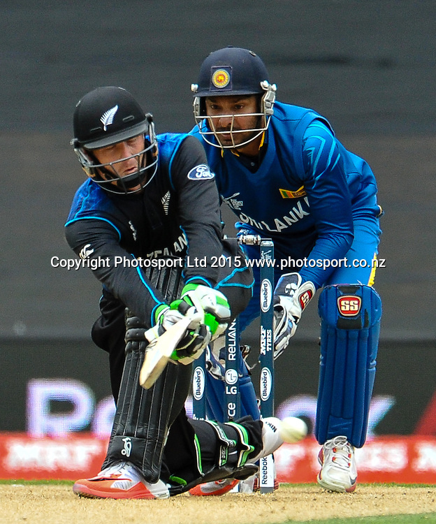 Martin Guptill of the Black Caps batting  with Kumar Sangakkara of Sri Lanka looking on during the ICC Cricket World Cup match between New Zealand and Sri Lanka at Hagley Oval in Christchurch, New Zealand. Saturday 14 February 2015. Copyright Photo: John Davidson / www.Photosport.co.nz