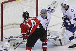 Mar 29; Newark, NJ, USA; Tampa Bay Lightning goalie Dwayne Roloson (30) makes a pad save on New Jersey Devils center Adam Henrique (14) during the third period at the Prudential Center. The Devils defeated the Lightning 6-4.