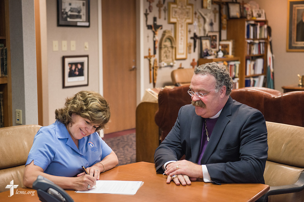 Patti Garibay, national executive director of American Heritage Girls, signs a Memorandum of Understanding with LCMS President Rev. Dr. Matthew C. Harrison on Wednesday, May 14, 2014, at the International Center of The Lutheran Church--Missouri Synod in Kirkwood, Mo.  LCMS Communications/Erik M. Lunsford