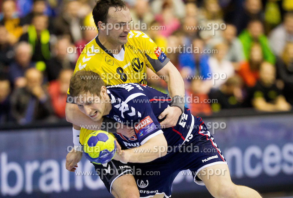 Peter Pucelj of Gorenje vs Steffen Weinhold of Flensburg during handball match between RK Gorenje Velenje (SLO) and SG Flensburg-Handewitt (GER) of Last 16 First Leg match of EHF Champions League 2012/13 on March 17, 2012 in Red Arena, Velenje, Slovenia. (Photo by Vid Ponikvar / Sportida.com)