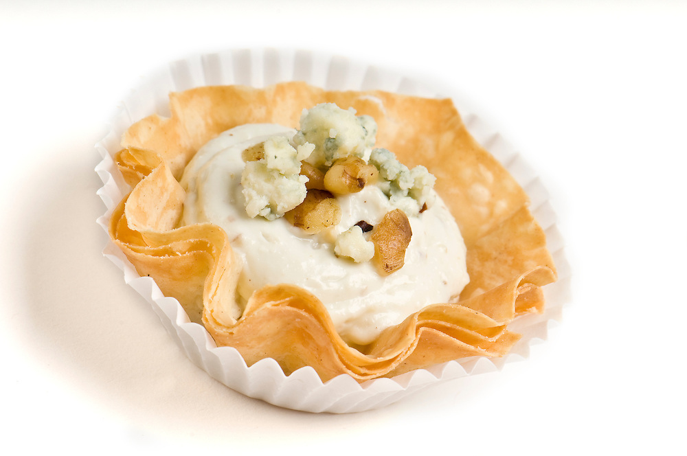 Blue Cheese and walnut Volauvent. Volauvent is a tiny round canapé made of puff pastry. The term ' vol au vent ' means ' blown by the wind ' in French.