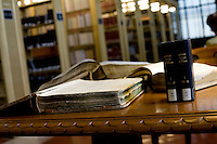 15 July, 2008. New York, NY. Books acquired from the New York Public Library sit on a table of the reading room of the NYPL. Note: book on top (a &quot;Test book&quot; of the Emigrants Savings Bank) belongs to NYPL. Up to 75,000 pieces were acquired from The Genealogical Society by the New York Public Library. The entire collection will be received between August and September and will then be cataloged for several years.<br /> <br /> &copy;2008 Gianni Cipriano for The New York Times<br /> cell. +1 646 465 2168 (USA)<br /> cell. +1 328 567 7923 (Italy)<br /> gianni@giannicipriano.com<br /> www.giannicipriano.com