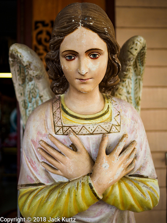 23 DECEMBER 2018 - CHANTABURI, THAILAND: A statue of an angel in the Vietnamese Catholic community near the Immaculate Conception Cathedral in Chantaburi. The Cathedral of the Immaculate Conception in Chantaburi. It is the largest Catholic church in Thailand and was founded more than 300 years ago by Vietnamese Catholics who emigrated to Thailand. The current cathedral building was sited and construction started while Chantaburi was occupied by French forces that had occupied neighboring Cambodia. The cathedral was finished after the French were expelled from Thailand. Chantaburi is the capital city of Chantaburi province on the Chantaburi River. Because of its relatively well preserved tradition architecture and internationally famous gem market, Chantaburi is a popular weekend destination for Thai tourists.   PHOTO BY JACK KURTZ