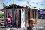 A little house with a satellite dish at the Roma settlement 'Budulovska Street' in Moldava nad Bodvou. The city has roughly 11200 inhabitants, about 1980 (18%) of them have Roma ethnicity and around 800 are living at the segregated settlement 'Budulovska Street' (2014).