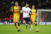Erik Lamela of Tottenham Hotspur (11) battles for possession with Brighton and Hove Albion midfielder Dale Stephens (6) during the Premier League match between Tottenham Hotspur and Brighton and Hove Albion at Wembley Stadium, London, England on 13 December 2017. Photo by Matthew Redman.