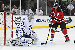 Mar 23; Newark, NJ, USA; Toronto Maple Leafs goalie James Reimer (34) makes a save while New Jersey Devils left wing Zach Parise (9) looks for the rebound during the second period at the Prudential Center.