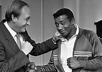 Former World Boxing Champion Floyd Patterson meeting the Minister for Sport Sean Barrett at Government Buildings, 08/10/1986 (Part of the Independent Newspapers Ireland/NLI Collection).