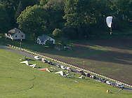 Ellenville, NY - A paraglider comes in for a landing at Ellenville Flight Park on May 30, 2009.