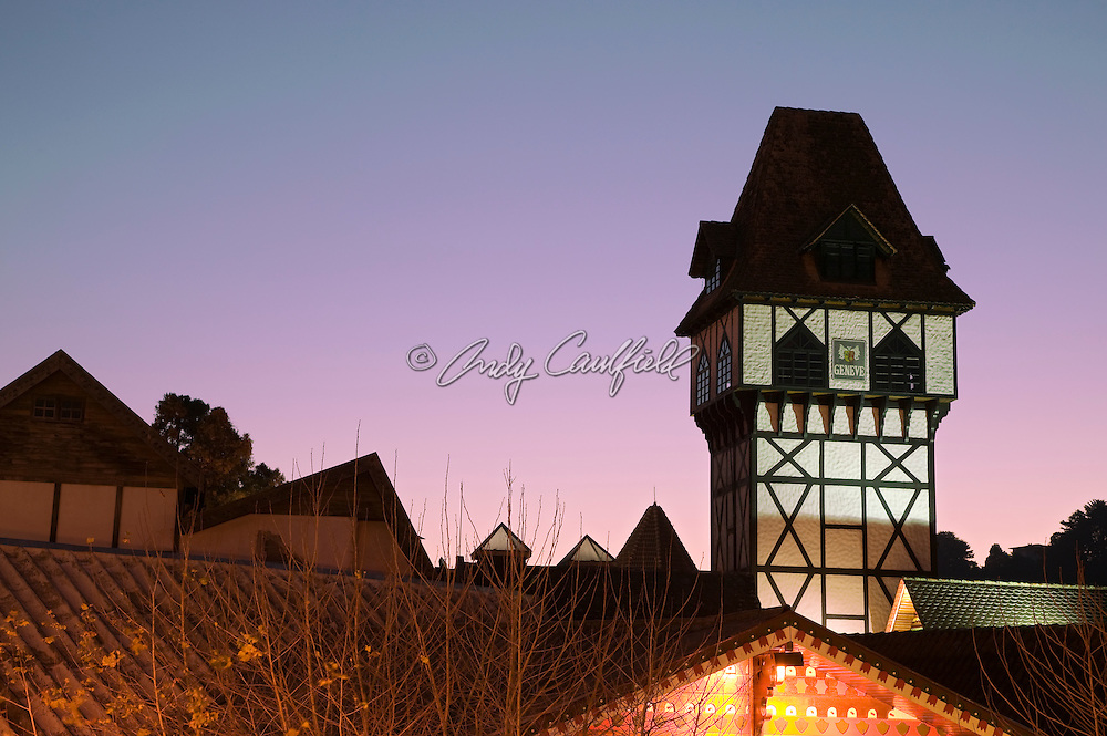Geneve tower and rooftops at dusk in the center of Vila Capivari, Campos do Jordao, SP, Brazil.