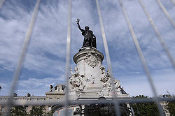 People walk by city employees as they clean graffitis of the statue of Place de la Republique in Paris, on August 2, 2016 which had become a makeshift memorial in tribute to the victims of the recent attacks of the last two years. The City of Paris began on August 1, 2016 a large cleaning operation of the statue in the center of the square of the Republic, whose pedestal has become after each terrorist attack where people deposited flowers, candles or poems in tribute and support. Archivists of the city, as they have done several times in recent months, had to first select the last objects or documents and photograph texts, drawings, graffiti, related to the attacks, before scanning to preserve those testimonies. Photo by Eliot Blondet / ABACAPRESS.COM