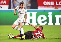 Luke Shaw of Manchester United makes a sliding tackle on Gareth Bale of Real Madrid in the first half during International Champions Cup action at Hard Rock Stadium in Miami Gardens, FL, USA on Tuesday, July 31, 2018. Manchester United won, 2-1. Photo by Jim Rassol/Sun Sentinel/TNS/ABACAPRESS.COM