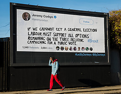 "© Licensed to London News Pictures. 14/02/2019. London, UK.  A man walks past a new Jeremy Corbyn billboard from ""Led By Donkeys"" that has been put up in Mr Corbyn's Islington constituency with a message asking for Labour party support on a pubic vote on Brexit. A previous billboard, errected in the same place on Monday was reportedly removed by Islington Council, who later replaced the blank board when challenged. Photo credit: Vickie Flores/LNP"