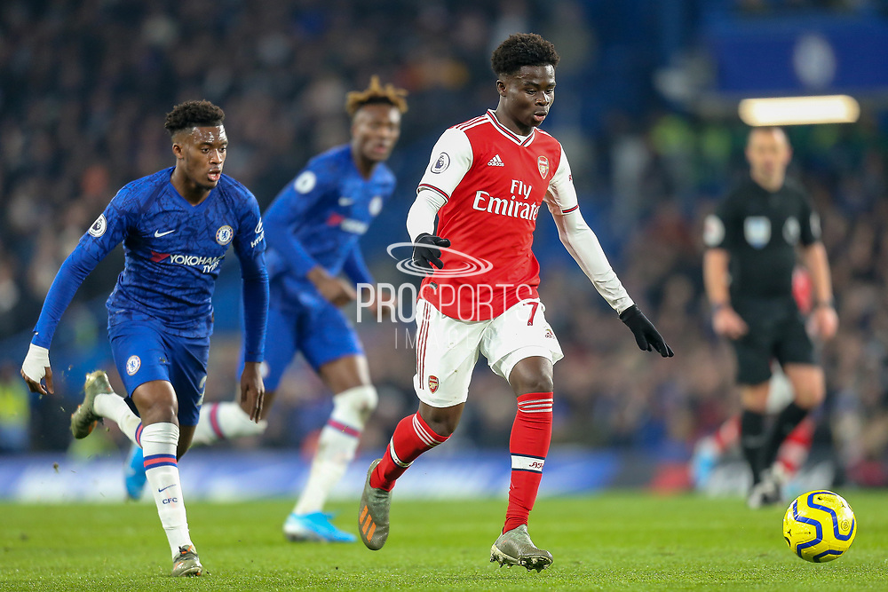 Arsenal midfielder Bukayo Saka (77) pursued by Chelsea midfielder Callum Hudson-Odoi (20) during the Premier League match between Chelsea and Arsenal at Stamford Bridge, London, England on 21 January 2020.